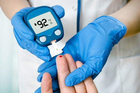 blood sugar: Doctor woman measuring glucose level blood in hospital close-up Stock Photo