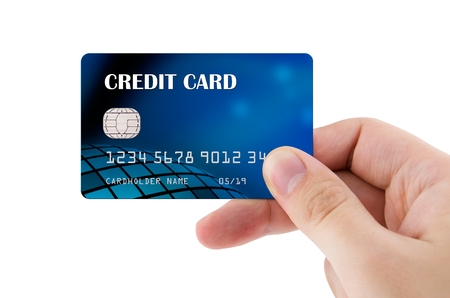 Hand holding plastic credit card Stock Photo