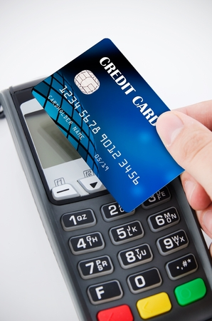 contactless: Contactless payment card with NFC chip using with terminal device Stock Photo