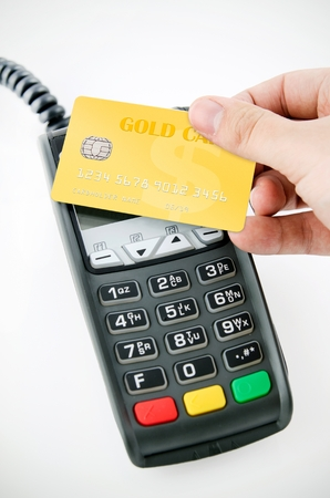 credit card bills: Contactless gold payment card with NFC chip using with terminal device