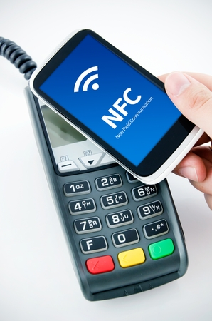 contactless: Contactless payment card with NFC chip in smart phone