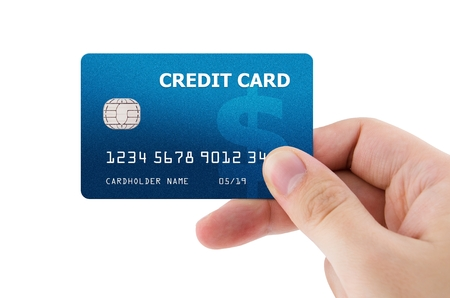 hand card: Hand holding plastic credit card Stock Photo