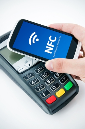 wireless terminals: Contactless payment card with NFC chip in smart phone