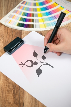 Graphic designer working with modern digitized pen