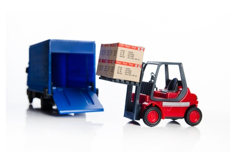 forklift truck: Forklift truck toys with boxes. Concept of international freight transport