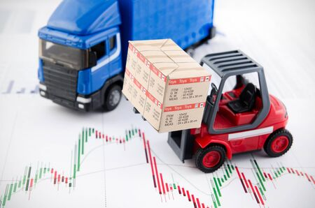transport truck: Forklift truck toys with boxes. Concept of international freight transport on business background
