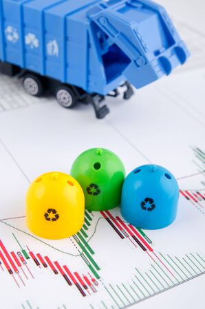 garbage truck: Colored trash bins and garbage truck toys on business background