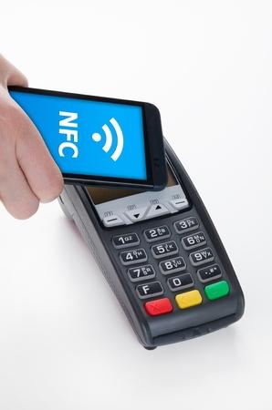 野原コミュニケーション ・ テクノロジーの近くで NFC モバイル決済 写真素材 - 38210966