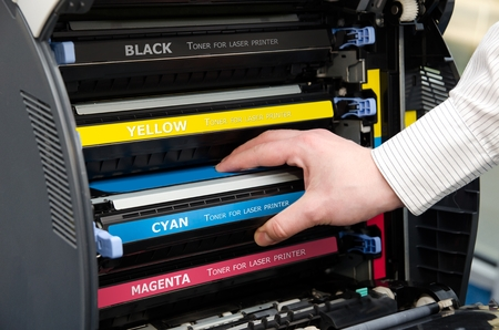 black color: Man puts toner in the printer Stock Photo