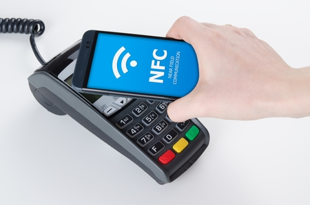 business card in hand: Mobile payment with NFC near field communication technology