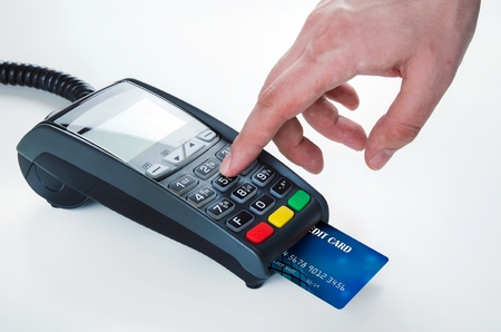 reader: Hand with credit card swipe through terminal for sale