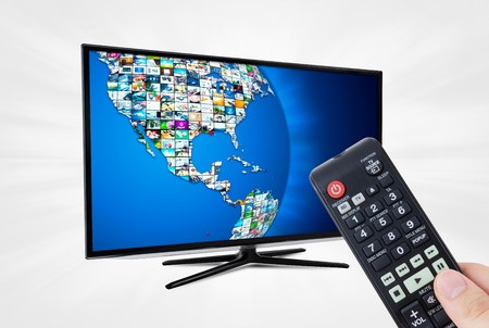 high definition: Widescreen high definition TV screen with sphere video gallery. Remote control in hand