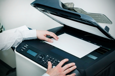 multifunction: Man using scanner multifunction device in office