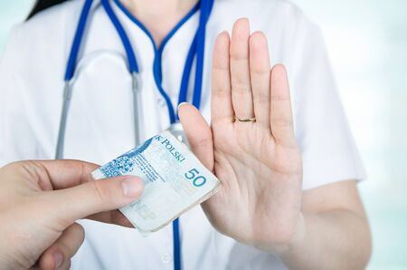 unethical: Polish woman doctor refusing kickbacks or bribes. Stock Photo