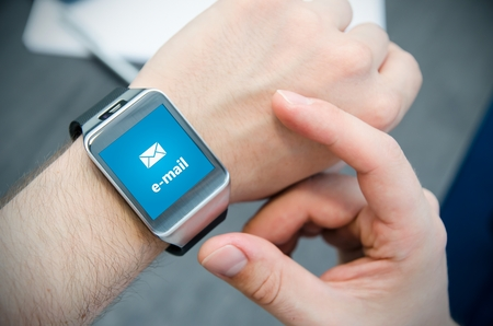 hour hand: New e-mail notification on smart watch connected to smart phone