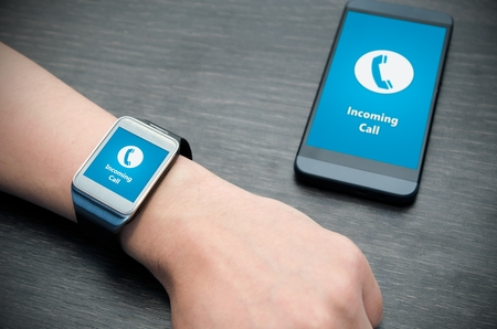 incoming: Incoming call notification on smart watch connected to smart phone