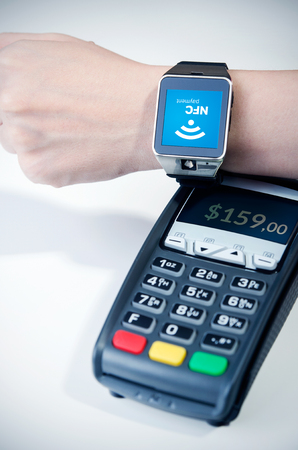 reader: Man using smart watch with NFC chip. Fast contactless payment