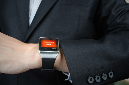 receives: Close up of businessman receives message notification on smart watch