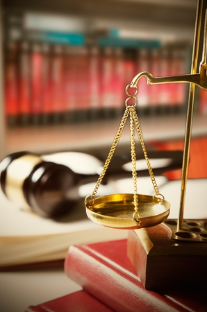 trial balance: Scale of Justice. Law composition with gavel on books in background