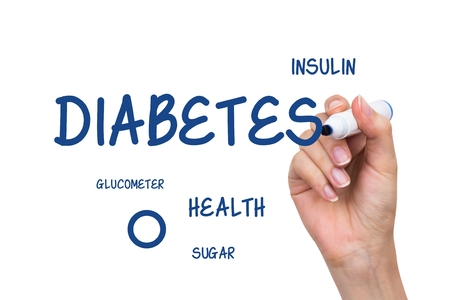 Hand writing diabetes healthcare content with blue marker on virtual whiteboard Stock Photo
