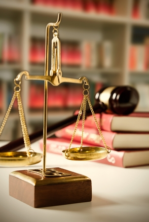justice scale: Scale of Justice. Law composition with gavel on books in background
