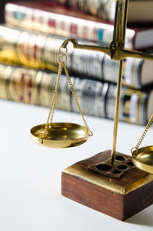 litigate: Weight scale and books. Scales of Justice and law concept