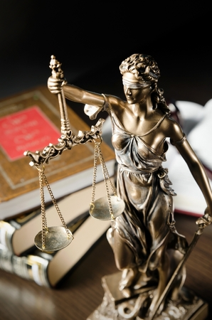 Law concept with Themis and books in background. Composition in court library