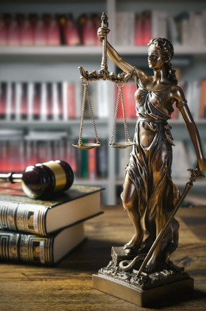 Themis and gavel in court library. Law conception Standard-Bild