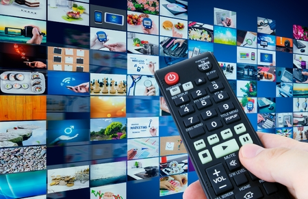 Television broadcast multimedia abstract composition with remote control Stock Photo