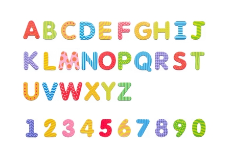 Colorful paper alphabet magnets on a whiteboard. Letters set isolated on white background Standard-Bild