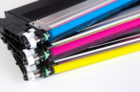 Toner cartridge set for laser printer. Computer supplies on white background. Stock Photo