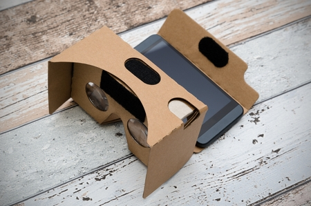 karton: Virtual reality cardboard glasses. Easy way to watch movies in 3D. Shoot on wooden background. Zdjęcie Seryjne
