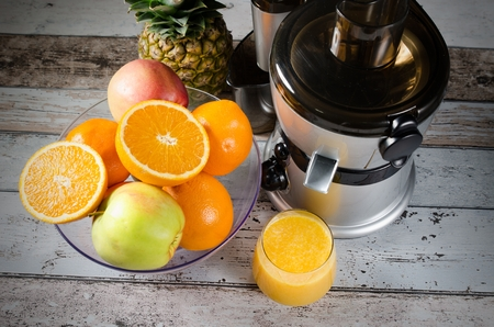 blender: Fresh juice and juicer. Photo on wooden background with lot of fruits