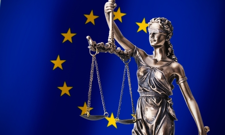 Themis with scale, symbol of justice on European Union flag background composition
