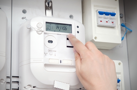 Electric energy meter. Electrical technician servicing unit Stock Photo