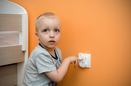 frolic: Child near to the socket. Electrical security of ac power for babies