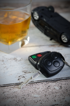 drinking and driving: Car keys, glass of whiskey in background. Drinking and driving Stock Photo