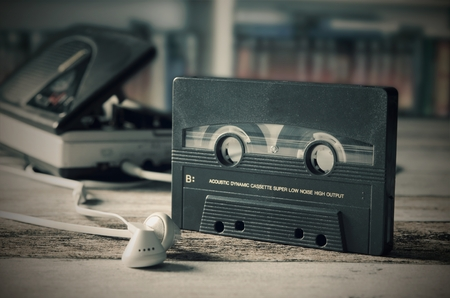 tape player: Old casette tape player. Retro style photo on wooden background