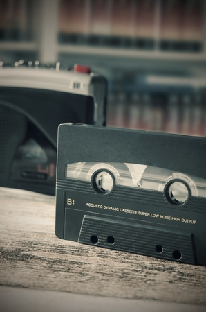 70s disco: Old casette tape player. Retro style photo on wooden background
