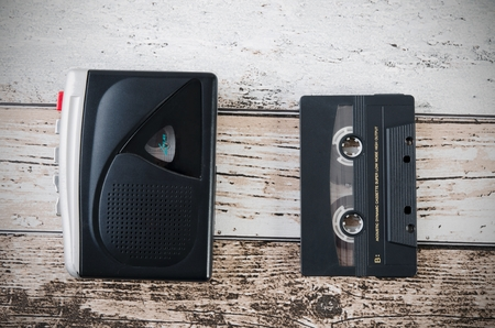 tape player: Old tape player, recorder and casette on wooden background. Top view composition.