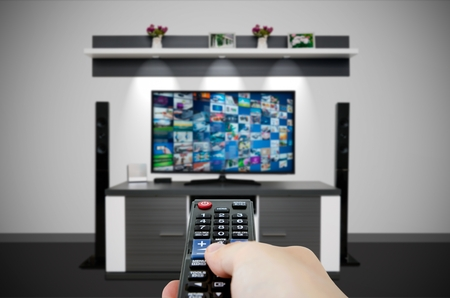 Television broadcast multimedia composition in room and remote control. Tv screen video broadcast internet concept Archivio Fotografico