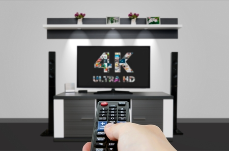 TV ultra HD. 4K television resolution technology. Watch TV in home cinema.