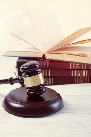 defendant: Law gavel and book composition. law gavel lawyer book wooden court attorney background concept