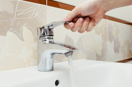 Man Unscrew The Faucet In The Bathroom. Utilities Water Bill Cost Rise Wash  Hand Composition
