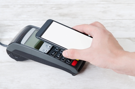 Mobile payment with smart phone. payment nfc near field communication phone credit card concept Фото со стока