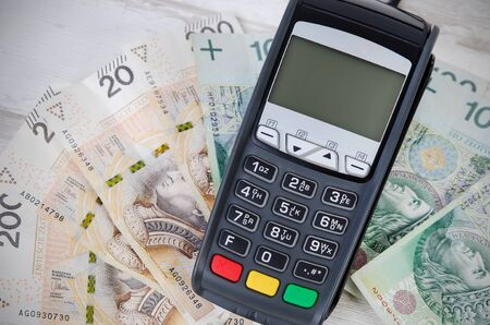 dispense: Credit card or cash concept top view. payment terminal credit cash polish zloty choice card concept Stock Photo