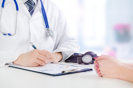 Doctor and patient medical consultation. doctor patient health care office desk stethoscope medical concept Banque d'images