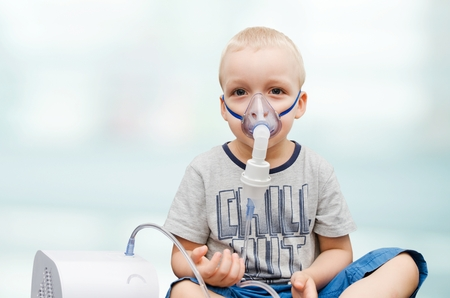 inhalation: Child making inhalation with mask on his face. Asthma problems concept