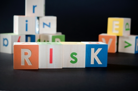 mediate: RISK word with colorful blocks. risk business leadership process finance cube blocks concept Stock Photo