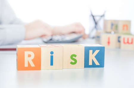 intervene: RISK word with colorful blocks. risk business leadership process finance cube blocks concept Stock Photo